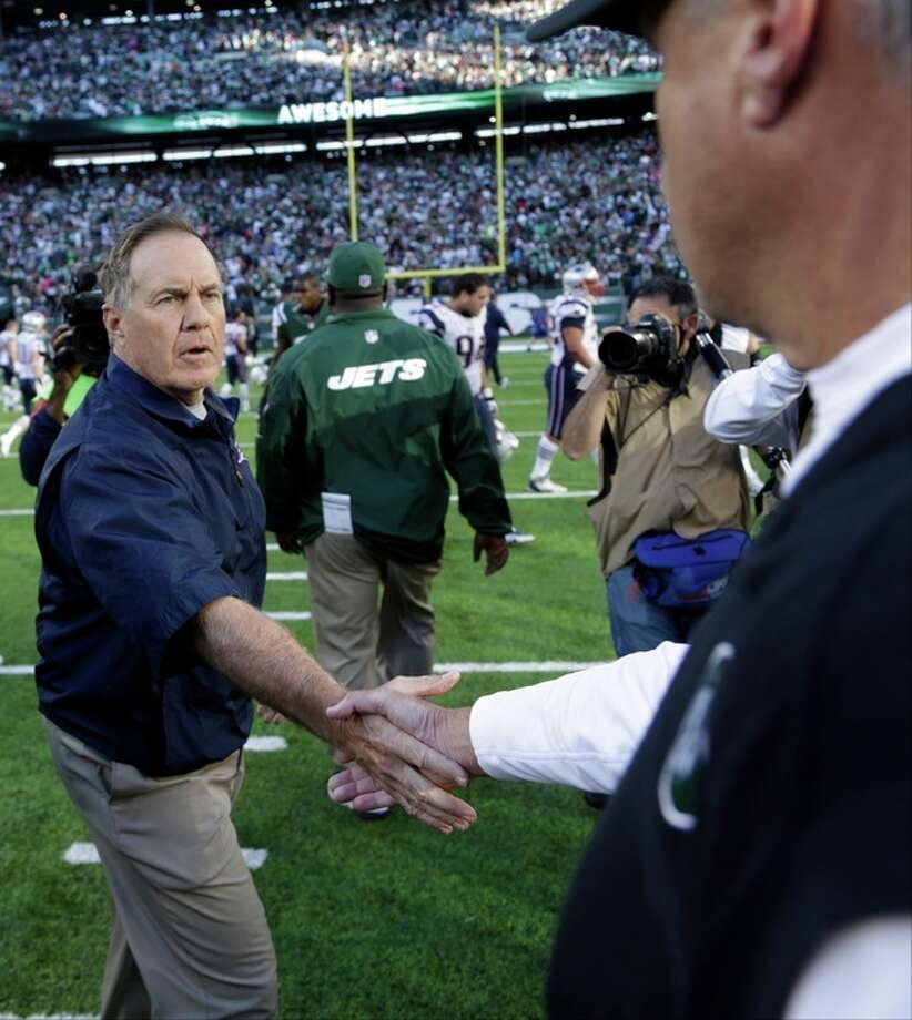 New England Patriots head coach Bill Belichick shakes hands with New York Jets head coach Rex Ryan after an NFL football game Sunday, Oct. 20, 2013 in East Rutherford, N.J. The Jets won the game 30-27. (AP Photo/Seth Wenig) / AP