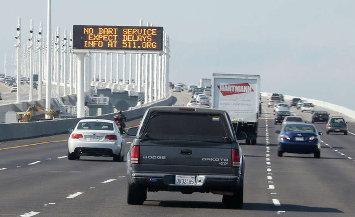 A traffic sign on the San Francisco-Oakland Bay Bridge alerts motorists to expect delays because of the BART transit strike Monday, Oct. 21, 2013, in Oakland, Calif. Frustrated San Francisco Bay Area commuters started the work week on Monday with gridlocked roadways and long lines for buses and ferries as a major transit strike entered its fourth day. (AP Photo/Eric Risberg)