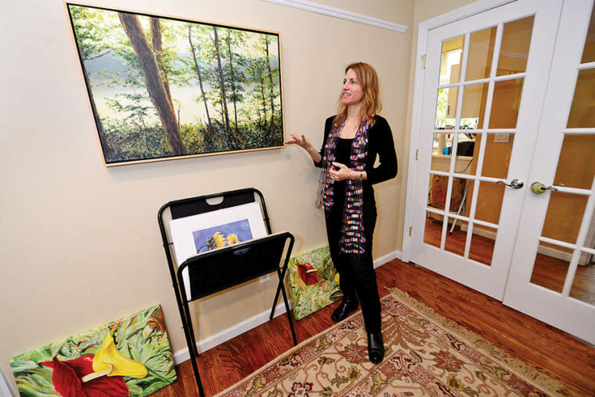 """Hour photo / Erik Trautmann Stamford artist Liron Sissmanwith her painting, """"There"""". Sissman's paintings that stimulate healing hang in many hospitals."""