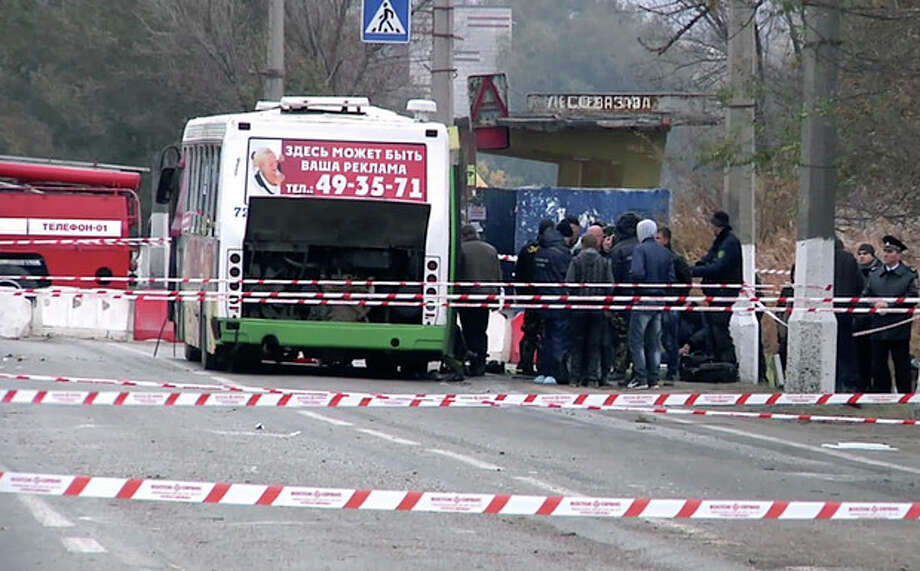 AP PhotoIn this image made from video experts and officials examine the wreckage of a bus following Monday's suicide bombing in Volgograd, Russia Tuesday, Oct. 22. A female suicide bomber blew herself up on the city bus in southern Russia on Monday, killing six people and injuring about 30, officials said. The attack in Volgograd added to security fears ahead of the Winter Olympics in Sochi. / AP Video