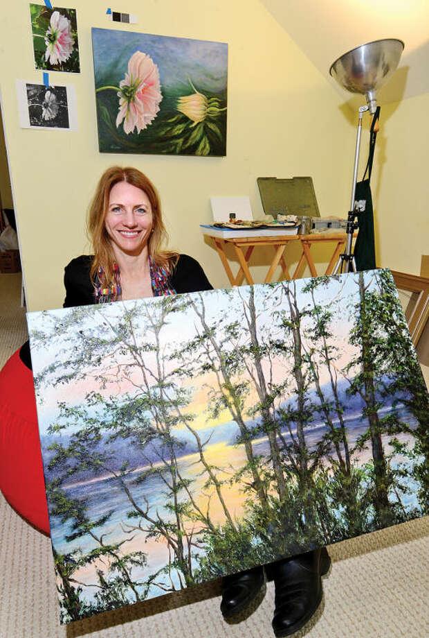 "Hour photo / Erik Trautmann Stamford artist Liron Sissmanwith her painting, ""Looking Beyond"". Sissman's paintings that stimulate healing hang in many hospitals."