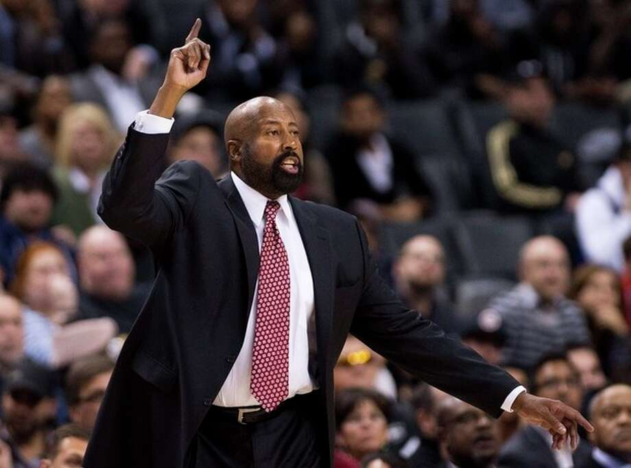 New York Knicks head coach Mike Woodson reacts while playing against the Toronto Raptors during second half NBA pre-season basketball action in Toronto on Monday, Oct. 21, 2013. (AP Photo/The Canadian Press, Nathan Denette) / CP