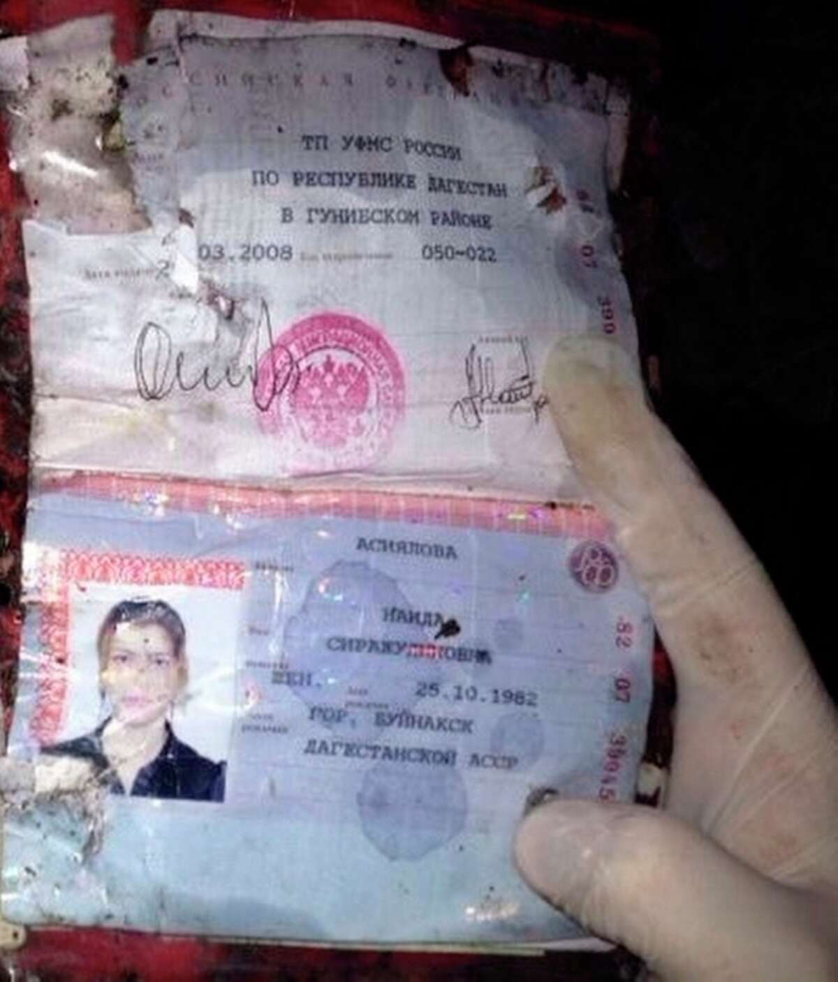 The photo provided by Russia's Investigative Committee on Tuesday, Oct. 22, 2013, shows the passport of Naida Asiyalova, a suspected suicide bomber. The Investigative Committee, Russia's main investigative agency, said that Asiyalova blew herself up on a bus in Russia's southern region of Volgograd on Monday, Oct. 21, killing six and wounding more than 30 others. (AP Photo)