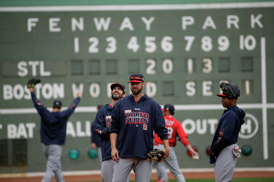 St. Louis Cardinals players warm up before batting practice for Game 1 of baseball's World Series against the Boston Red Sox Tuesday, Oct. 22, 2013, in Boston. (AP Photo/Matt Slocum) / AP
