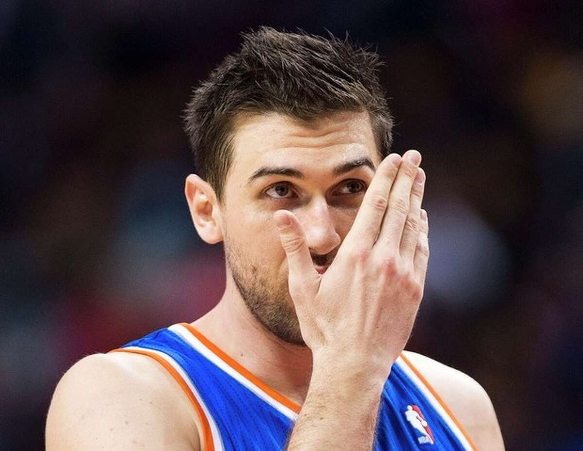 New York Knicks forward Andrea Bargnani gets ready to shoot a free throw against the Toronto Raptors during first half NBA pre-season basketball action in Toronto on Tuesday, Oct. 21, 2013. (AP Photo/The Canadian Press, Nathan Denette)