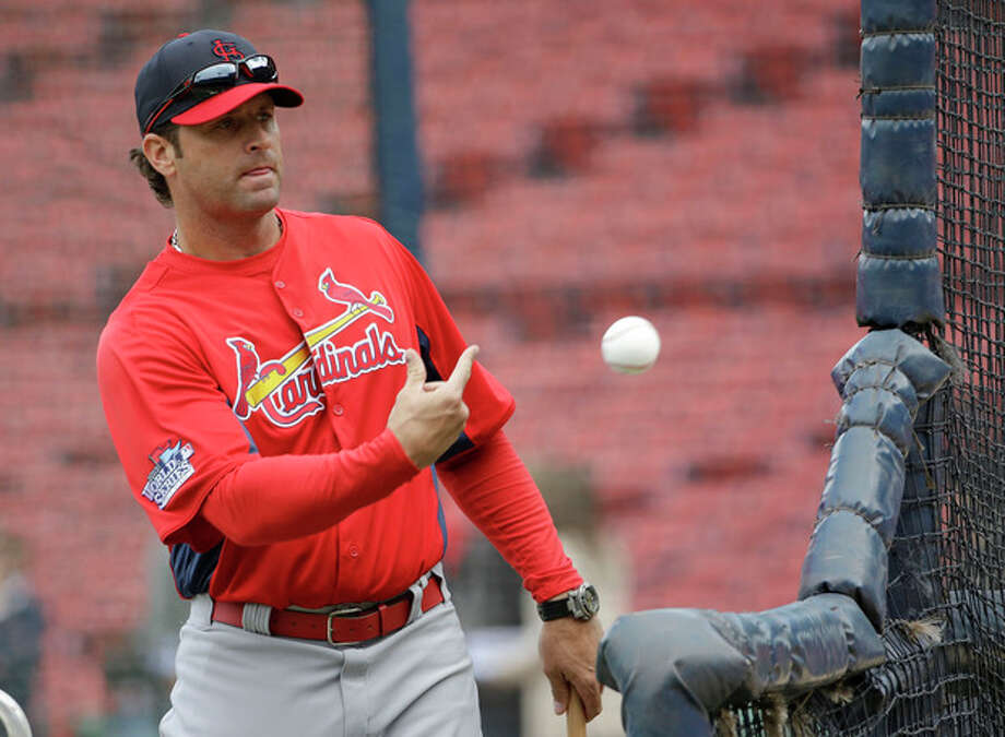 St. Louis Cardinals manager Mike Matheny tosses a ball during batting practice for Game 1 of baseball's World Series against the Boston Red Sox Tuesday, Oct. 22, 2013, in Boston. (AP Photo/David J. Phillip) / AP