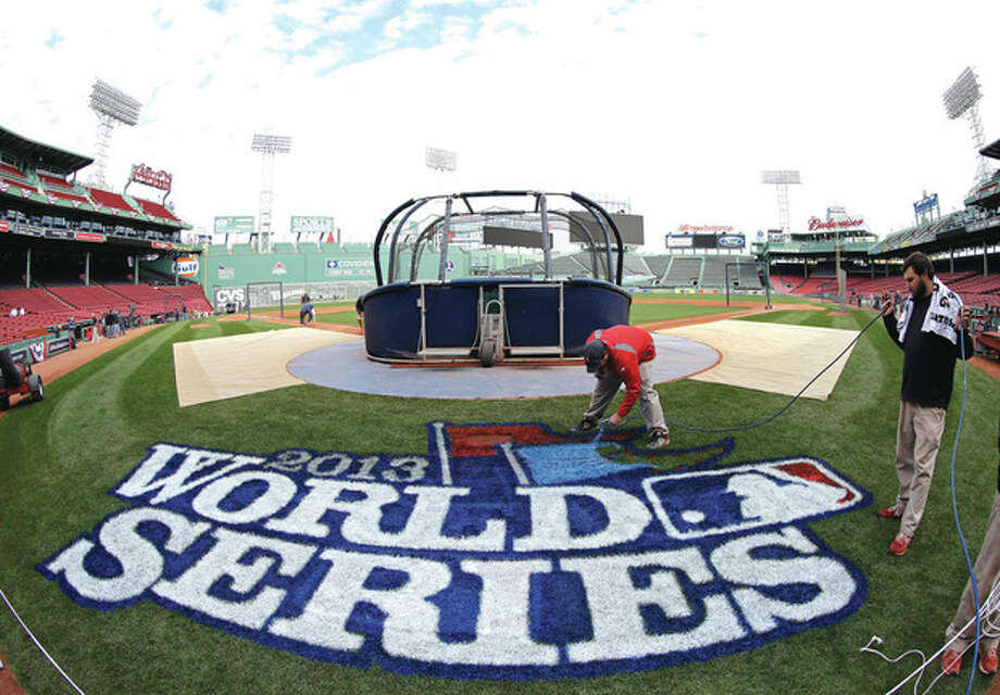 AP photoA worker puts the finishing touches on the 2013 World Series logo on the field at Fenway Park. The Series opens Wednesday night when the St. Louis Cardinals face the Boston Red Sox in Game 1 at Fenway. / AP