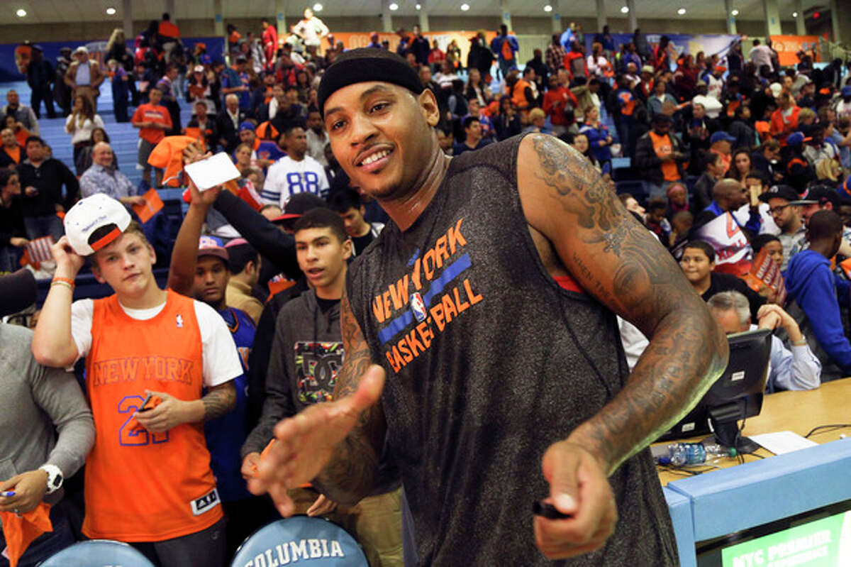 New York Knicks forward Carmelo Anthony greets fans after an NBA basketball scrimmage at Columbia University, Sunday, Oct. 20, 2013, in New York. (AP Photo/John Minchillo)