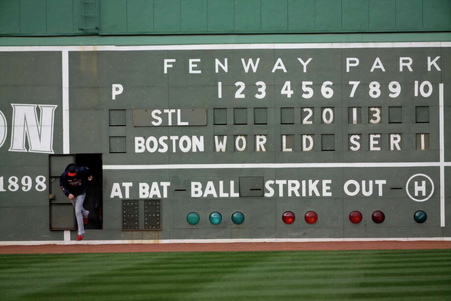 St. Louis Cardinals' Michael Wacha runs out of a scoreboard under the Green Monster before batting practice for Game 1 of baseball's World Series against the Boston Red Sox Tuesday, Oct. 22, 2013, in Boston. (AP Photo/David J. Phillip) / AP
