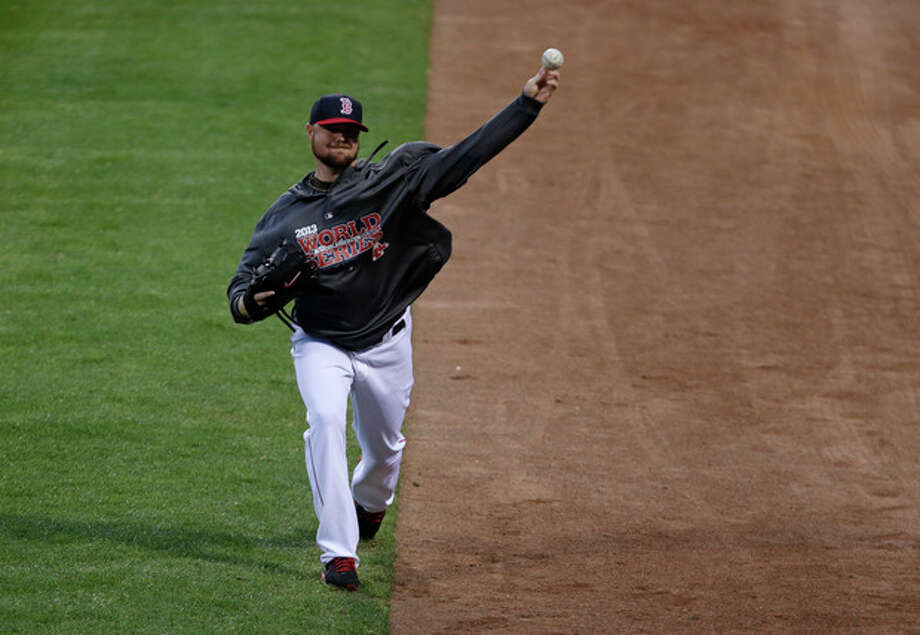 Boston Red Sox starting pitcher Jon Lester throws during a baseball workout Tuesday, Oct. 22, 2013, in Boston. Lester is scheduled to start Game 1 of baseball's World Series on Wednesday against the St. Louis Cardinals. (AP Photo/Charles Krupa) / AP