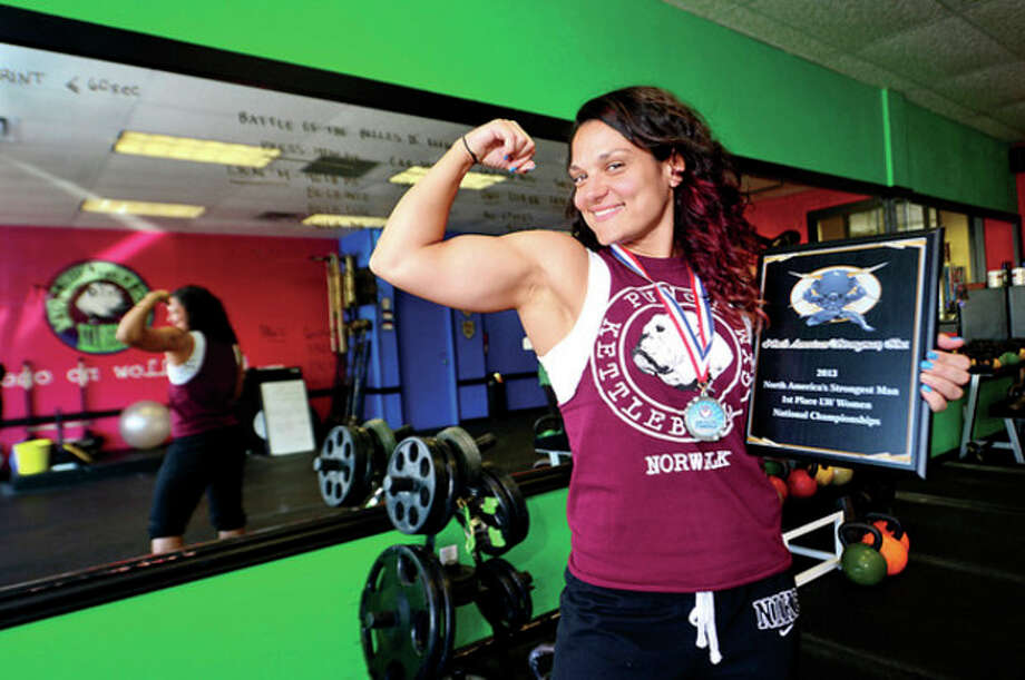 Hour photo / Erik TrautmannPunch Kettleball Gym owner Stefanie Tropea won the title of America's Strongest Woman in her division at a competition over the weekend. / (C)2013, The Hour Newspapers, all rights reserved