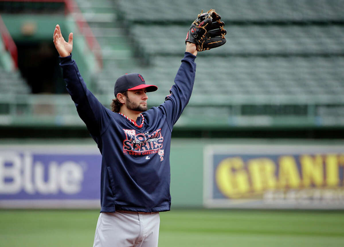 St. Louis Cardinals' Pete Kozma stretches during batting practice for Game 1 of baseball's World Series against the Boston Red Sox Tuesday, Oct. 22, 2013, in Boston. (AP Photo/David J. Phillip)