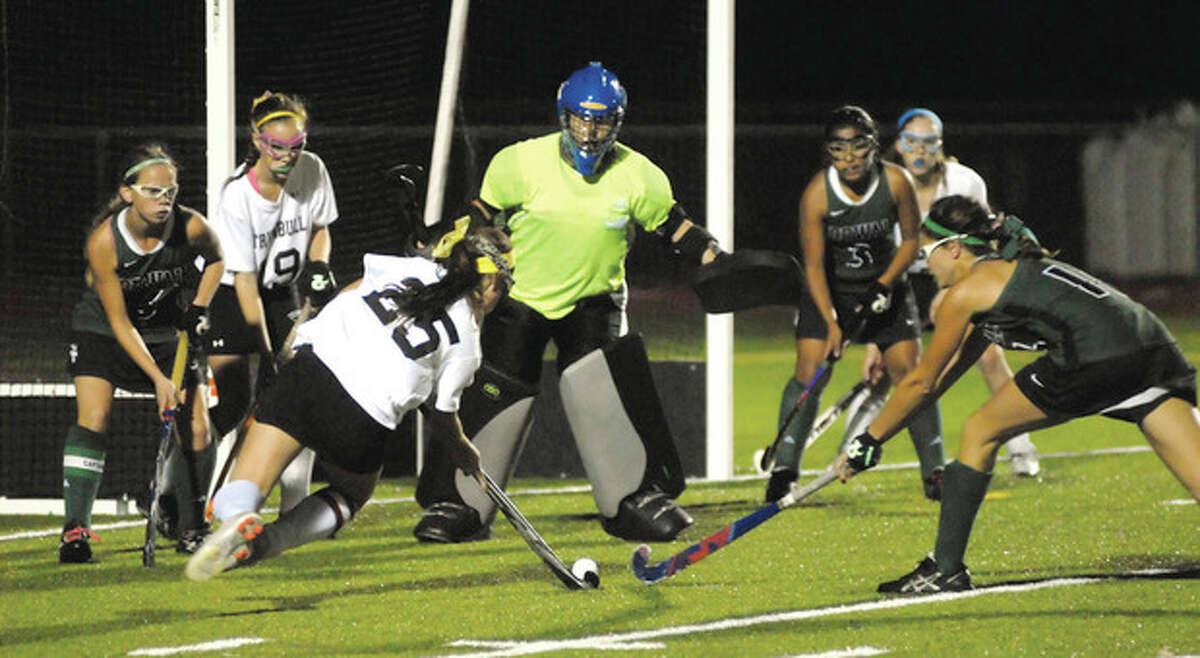 Hour photo/John Nash Norwalk goaltender Shannon O'Malley, center, keeps an eye on a shot by Trumbull's Jamie Appelberg as Bear teammates, from left, Greta McConnell, Sara Meza and Sam Bartush help defend. The Bears and Eagles tied 1-1.