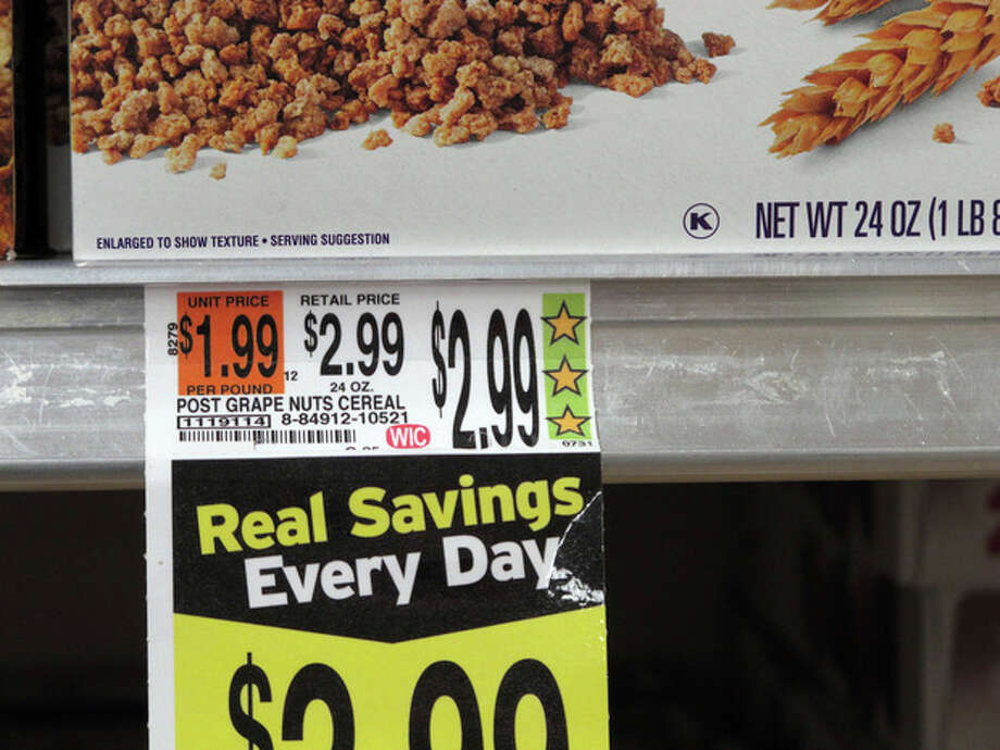 Hannaford grocery stores feature the company's Guiding Stars rating system, as shown on a cereal price tag at a South Portland, Maine, store on Wednesday, Oct. 23, 2013. A new study by researchers with the U.S. Department of Agriculture, the Food and Drug Administration and the University of Florida suggest that the rating system steers shoppers toward healthier choices in grocery stores. (AP Photo/Clarke Canfield) / AP