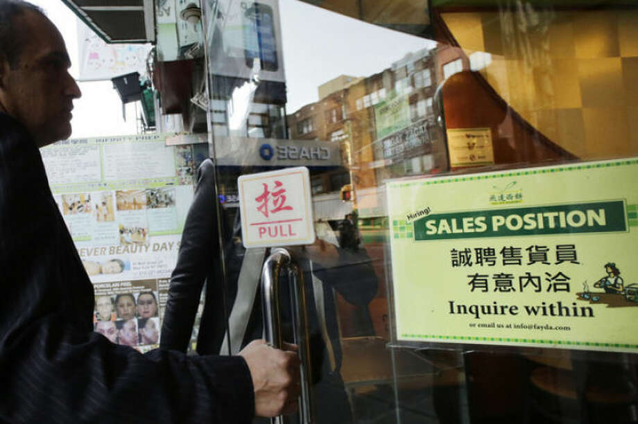 "A customer enters a Chinese bakery that has a sign posted in the door, ""Hiring! Sales Position Inquire within,"" Tuesday, Oct. 22, 2013, in New York. The U.S. economy added just 148,000 jobs in September, suggesting that employers held back on hiring before a 16-day partial government shutdown began Oct. 1. Still, hiring last month was enough to lower the unemployment rate. (AP Photo/Mark Lennihan)"