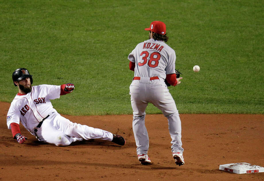 St. Louis Cardinals' Pete Kozma can't handle a throw as Boston Red Sox's Dustin Pedroia slides into second during the first inning of Game 1 of baseball's World Series Wednesday, Oct. 23, 2013, in Boston. (AP Photo/Charlie Riedel) / AP