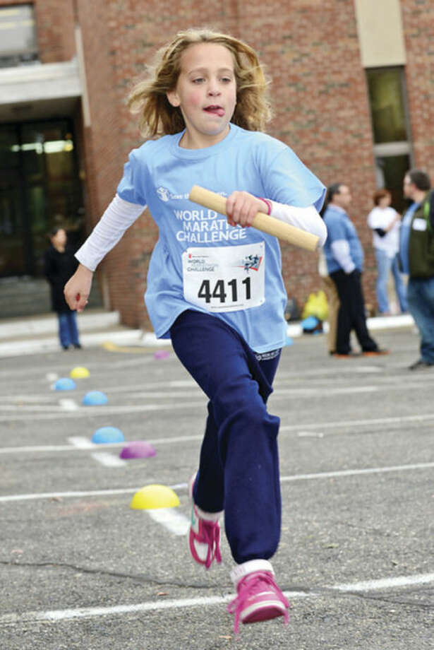 Hour photos / Erik TrautmannSide by Side 4th- and 5th-grade students, including Georgia Mendola, left, and Edgar Figuroa, right, participate in the World Marathon Challenge, a fundraiser for Save the Children on Wednesday.