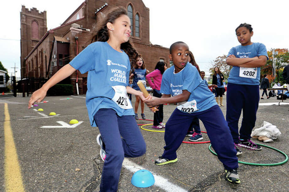 Side by Side 4th-grade students, including Destiny Ferreira and Darby Jean, participate in the World Marathon Challenge Wednesday. / (C)2013, The Hour Newspapers, all rights reserved