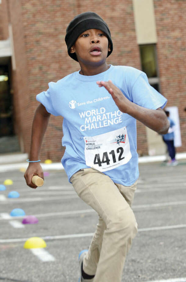 Hour photo / Erik Trautmann Side by Side Community School 4th and 5th graders including Edgar Figuroa participate in the World Marathon Challenge, a fundraiser for Save the Children Wednesday.