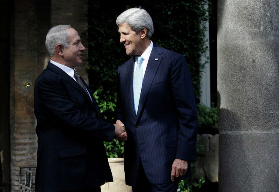 US Secretary of State John Kerry, right, and Israeli Prime Minister Benjamin Netanyahu shake hands for the media on the occasion of their meeting at Villa Taverna, the US Ambassador's residence in Rome, Wednesday, Oct. 23, 2013. Netanyahu and Kerry are expected to talk about Iran's nuclear programme and peace negotiations with the Palestinians. (AP Photo/Gregorio Borgia, Pool) / AP POOL