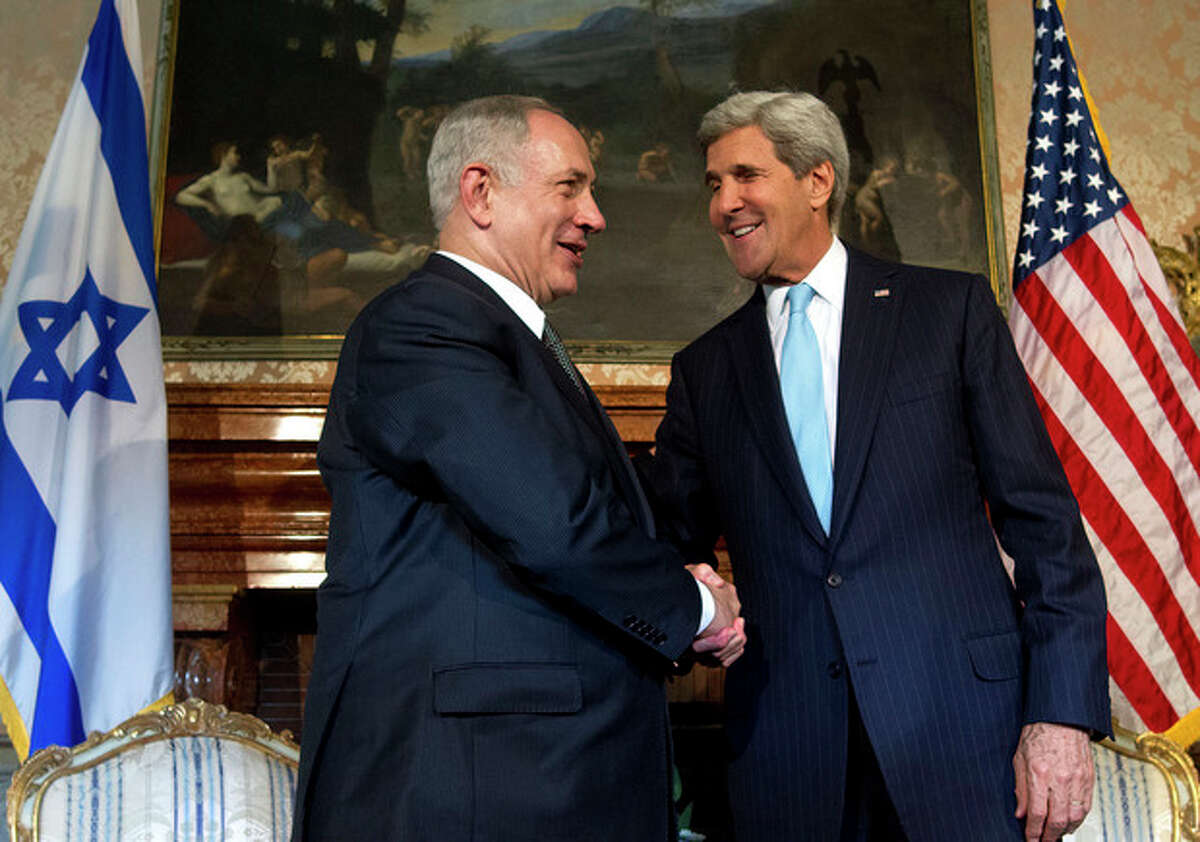 US Secretary of State John Kerry, right, and Israeli Prime Minister Benjamin Netanyahu shake hands for the media on the occasion of their meeting at Villa Taverna, the US Ambassador's residence in Rome, Wednesday, Oct. 23, 2013. Netanyahu and Kerry met in Rome during Kerry's last stop of his European tour and are expected to talk about Iran's nuclear programme and peace negotiations with the Palestinians. (AP Photo/Claudio Peri, Pool)