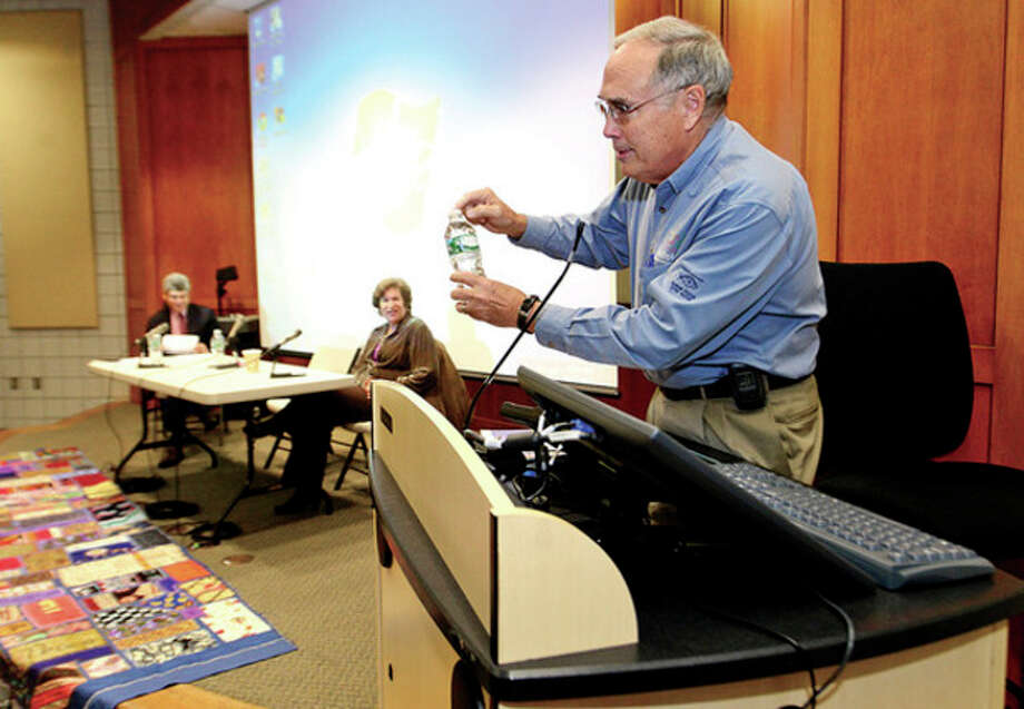 Hour photo / Erik TrautmannNorwalk Harbor / River Watch's ' Dick Harris speaks in the GE Forum as global, regional and local concerns about the future of water are discussed at a United Nations Day event at Norwalk Community College. / (C)2013, The Hour Newspapers, all rights reserved