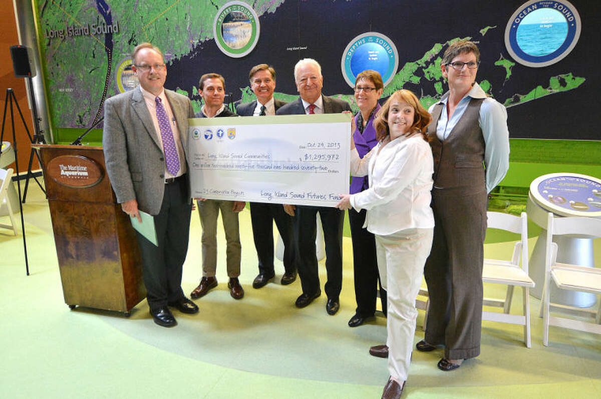 Hour Photo/Alex von Kleydorff A check for 1.2 million in funding is presented during the Grant Award announcement at The Maritime Aquarium for funds to improve the health of Long Island Sound. The projects will be funded through the Long Island Sound Futures Fund.
