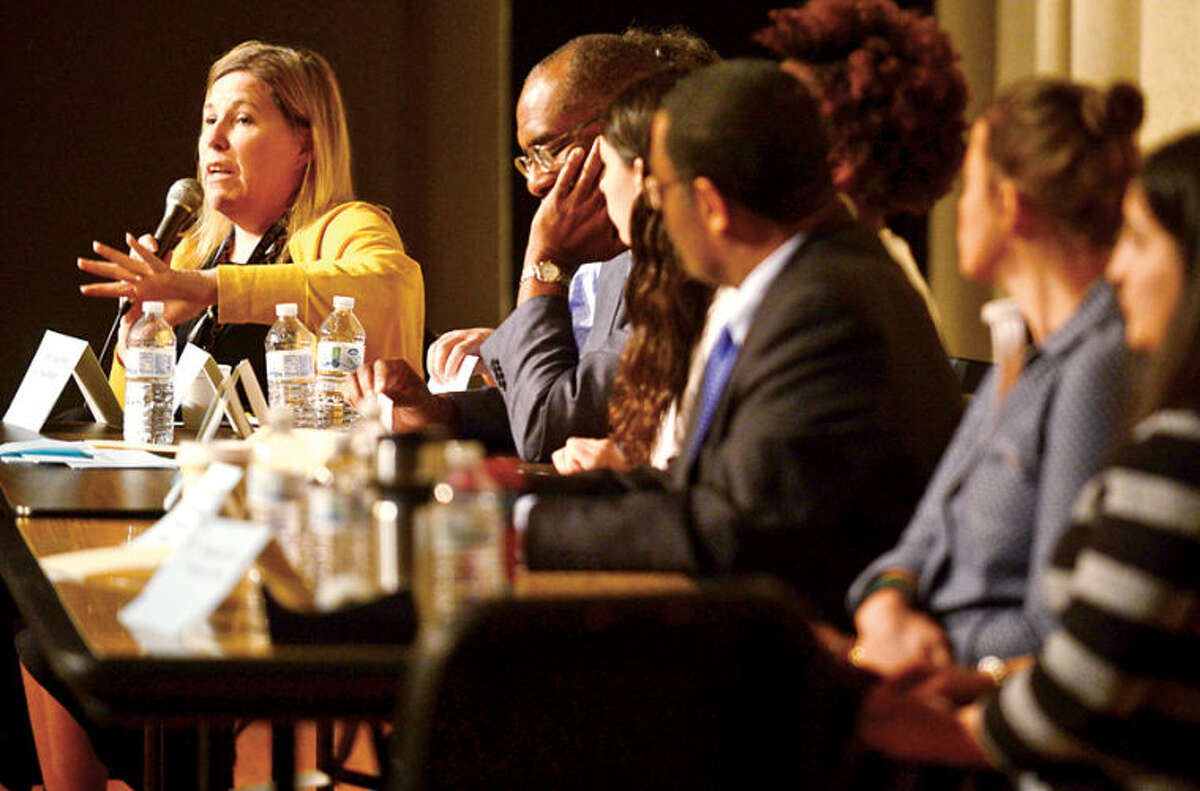 Hour photo / Erik Trautmann Brien McMahon High School housemaster Barbara Wood speaks as part of panel discussion as the school hosts it's annual Bully Day Wednesday.