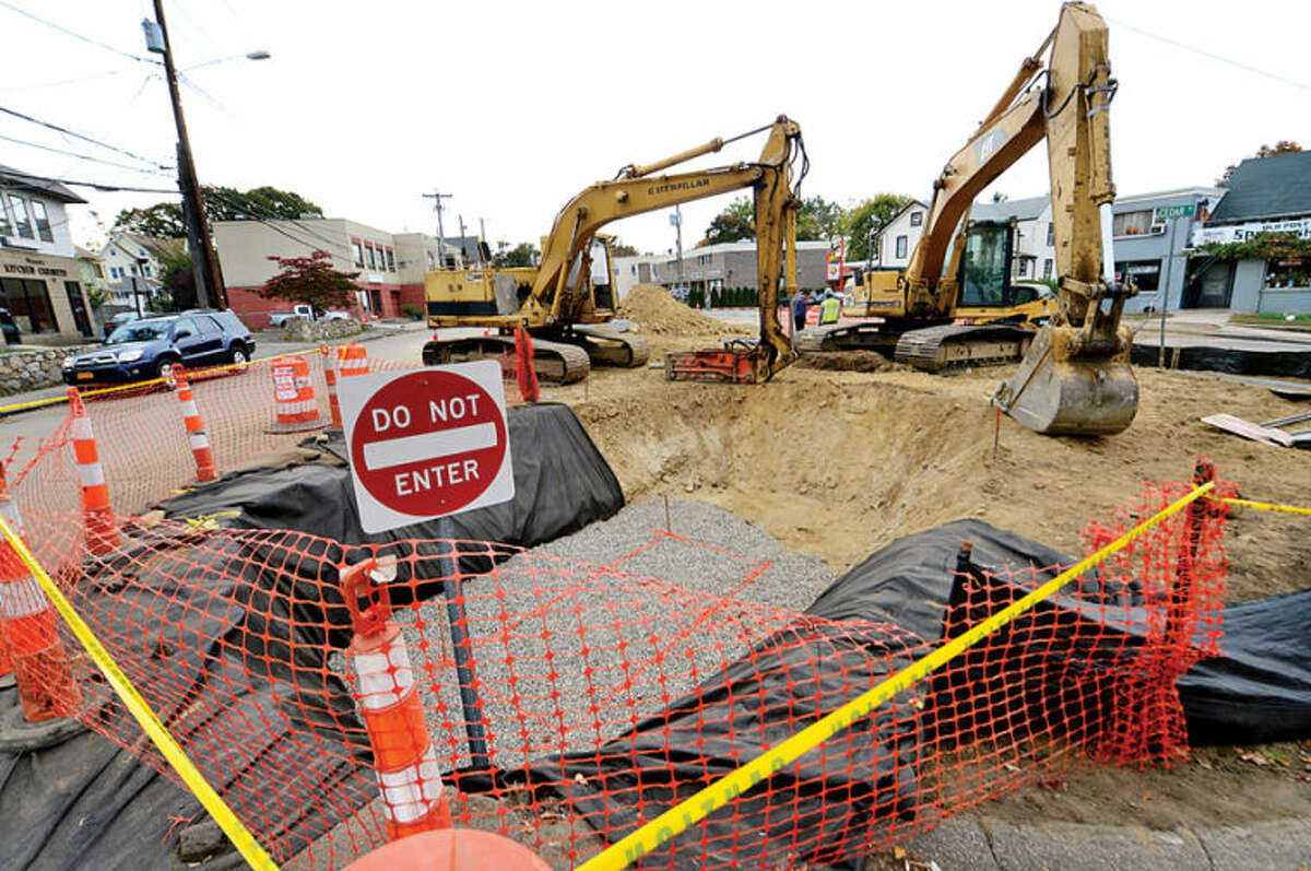 Hour photo / Erik Trautmann Construction has begun on street repair and sidewalk replacement on Cedar St. in Norwalk. Latino business owners on Cedar Street say they weren't notified by city of roadwork outside their doors,