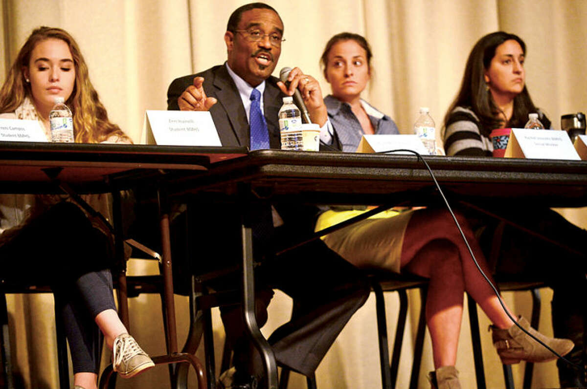 Hour photo / Erik Trautmann State Representative Bruce Morris (D-140) speaks as part of a panel discussion as Brien McMahon High School hosts it's annual Bully Day Wednesday.