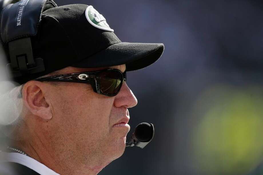 New York Jets head coach Rex Ryan stands on the sideline during the second half of an NFL football game against the New England Patriots on Sunday, Oct. 20, 2013, in East Rutherford, N.J. (AP Photo/Seth Wenig) / AP