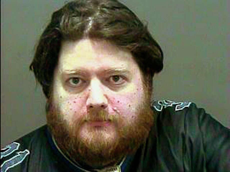 Aryn Leroux of West Haven, Conn., is seen in this booking photo provided by the West Haven Police Department. The Connecticut man has been charged with threatening New York Mets players, coaches and executives on Twitter postings. Authorities say Leroux of also made a threat against the Mets' ballpark, Citi Field. He was arrested Wednesday, Oct. 23, 2013 on misdemeanor threatening and breach of peace charges.(AP Photo/ West Haven Police Department) / West Haven Police Department