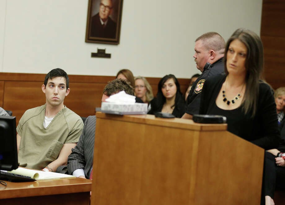Matthew Cordle, left, looks at Angela Canzani, the victims daughter, as she reads a statement during Cordle's sentencing Wednesday, Oct. 23, 2013, in Columbus, Ohio. Cordle was sentenced to 6 1/2 years in prison for causing a fatal wrong-way crash after a night of heavy drinking, which Cordle confessed to in an online video. Cordle had faced up to 8½ years for killing Vincent Canzani in a June 22 crash. He had been on his way home after a night of drinking at bars near downtown Columbus. (AP Photo/Tony Dejak) / AP