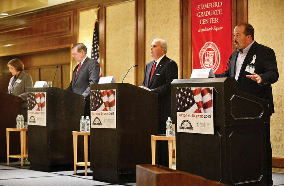Hour photo / Erik Trautmann Candidates for mayor of Stamford including Kathleen Murphy, Daivd Martin, Michael Fedele and John Zito answer questions during a debate sponsored by the Stamford Chamber of Commerce at the Stamford Hilton Thursday.