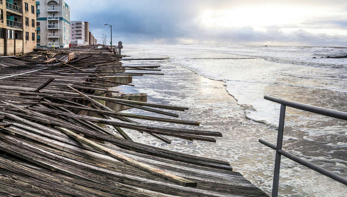 """In this Oct. 30, 2012 photo provided by the photographer, waves crash onto the battered boardwalk in Long Beach, N.Y., the morning after Superstorm Sandy struck.Tisi-Kramer's Long Island photo is one of 200 images of Sandy at an exhibition at the Museum of the City of New York. """"Rising Waters: Photographs of Sandy,?"""" opens Oct. 29 on the one-year anniversary of the storm. (AP Photo/Tisi-Kramer)"""