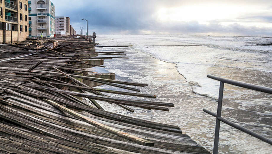 "In this Oct. 30, 2012 photo provided by the photographer, waves crash onto the battered boardwalk in Long Beach, N.Y., the morning after Superstorm Sandy struck.Tisi-Kramer's Long Island photo is one of 200 images of Sandy at an exhibition at the Museum of the City of New York. ""Rising Waters: Photographs of Sandy,"" opens Oct. 29 on the one-year anniversary of the storm. (AP Photo/Tisi-Kramer) / Christina Tisi-Kramer"