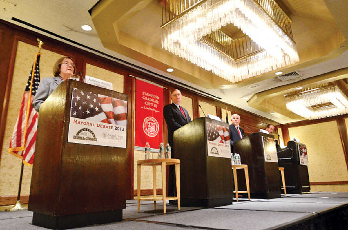 Hour photo / Erik Trautmann Candidates for mayor of Stamford Kathleen Murphy, David Martin, Michael Fedele and John Zito answer questions during a debate sponsored by the Stamford Chamber of Commerce at the Stamford Hilton Thursday.