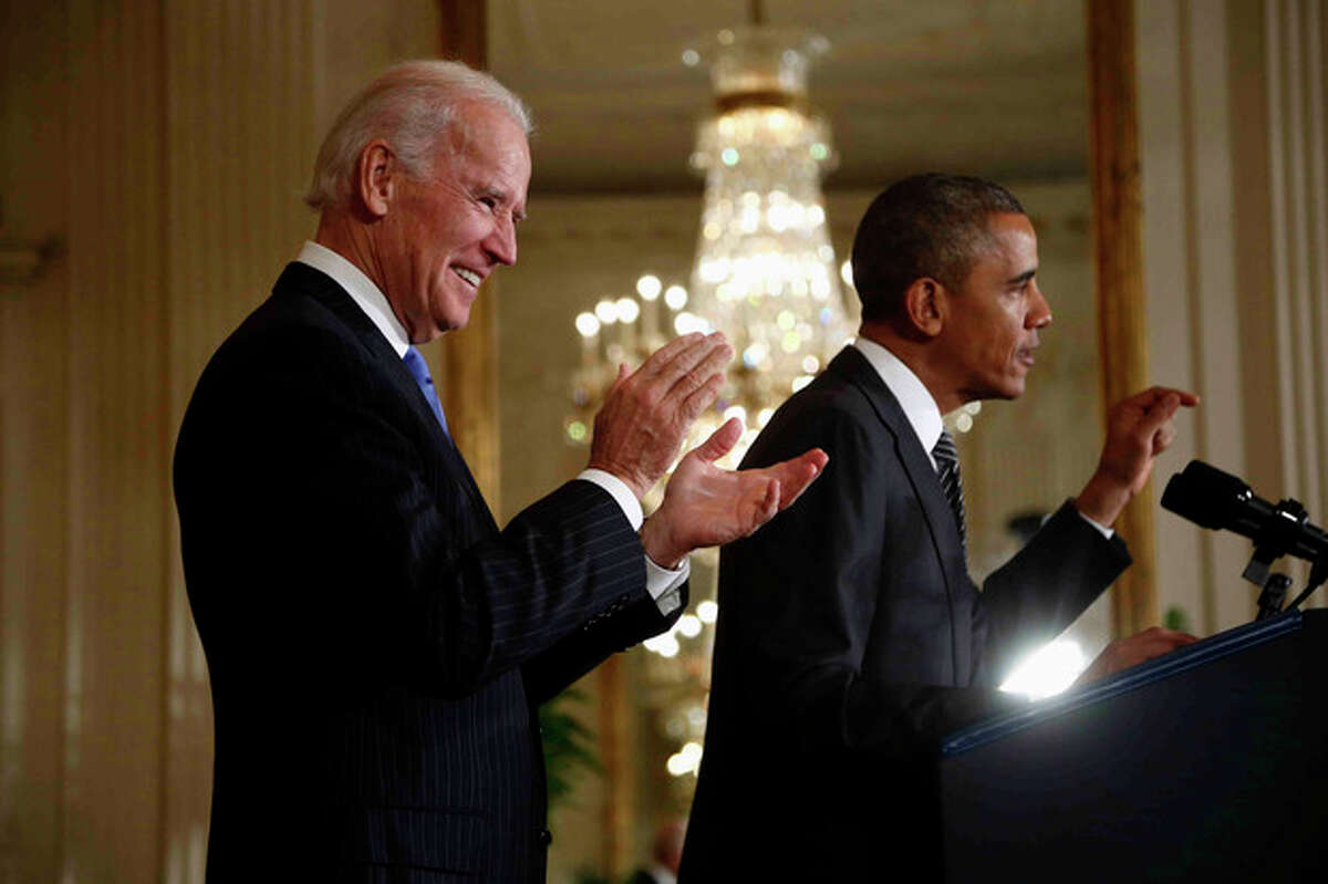 """Vice President Joe Biden applauds as President Barack Obama speaks about immigration reform, Thursday, Oct. 24, 2013, in the East Room of the White House in Washington. The president said now that the partial government shutdown is over, Republicans and Democrats should be able to work together to fix what he called """"a broken immigration system."""" (AP Photo/Charles Dharapak)"""