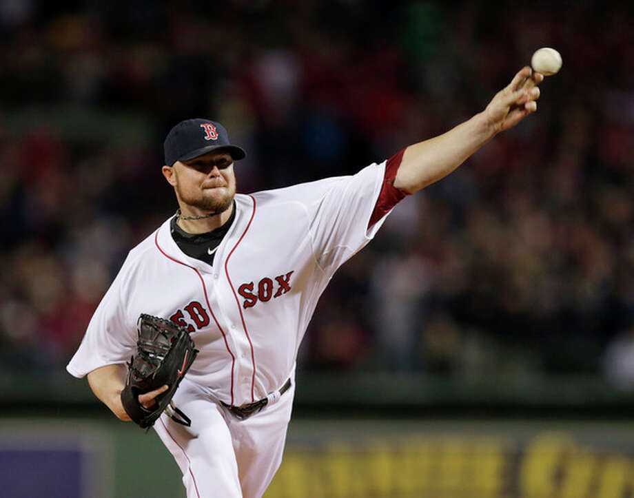Boston Red Sox starting pitcher Jon Lester throws during the first inning of Game 1 of baseball's World Series against the St. Louis Cardinals Wednesday, Oct. 23, 2013, in Boston. (AP Photo/Charles Krupa) / AP