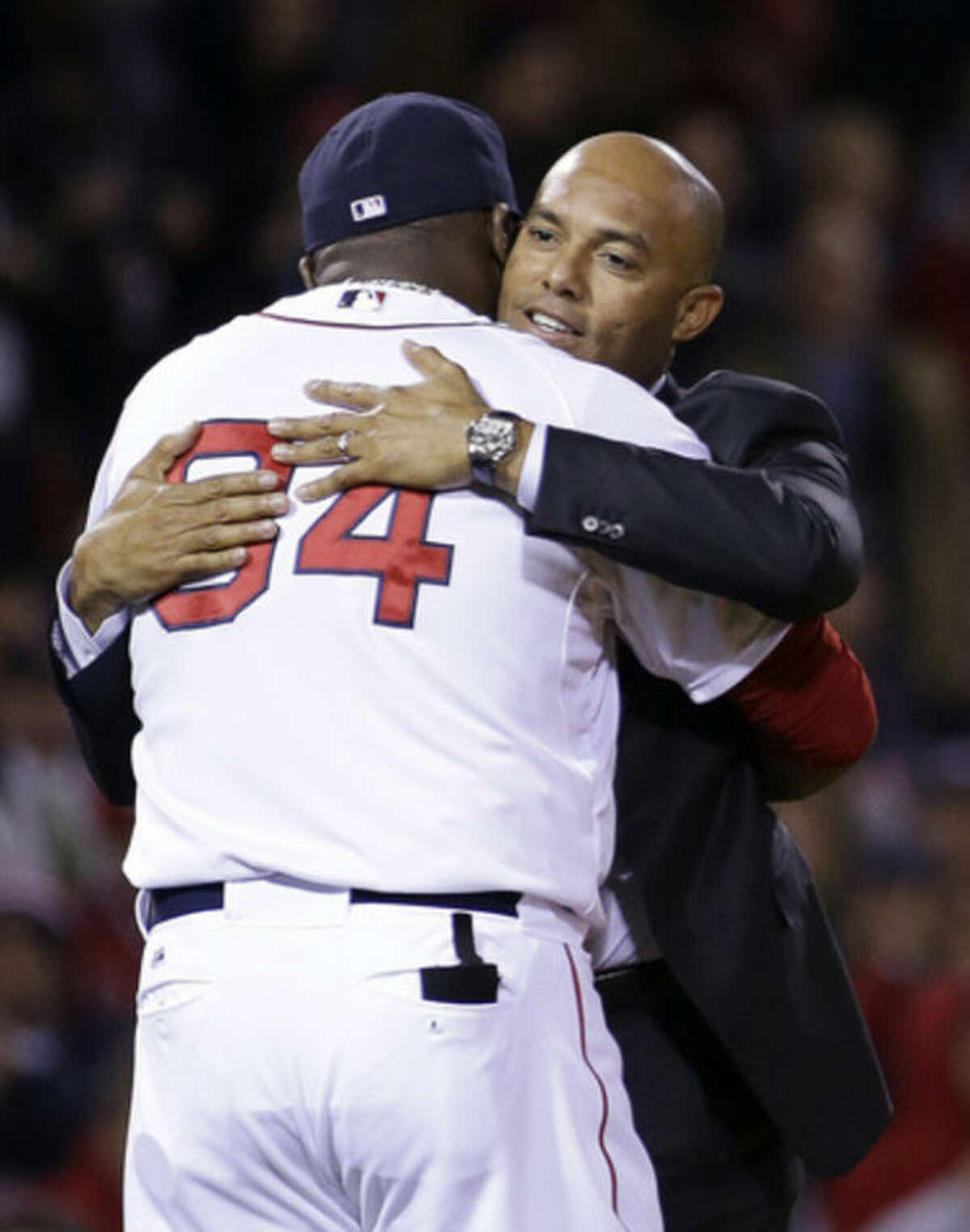 Former New York Yankee pitcher Mariano Rivera gets a hug from Boston Red Sox's David Ortiz before Game 2 of baseball's World Series between the Red Sox and St. Louis Cardinals Thursday, Oct. 24, 2013, in Boston. (AP Photo/David J. Phillip)