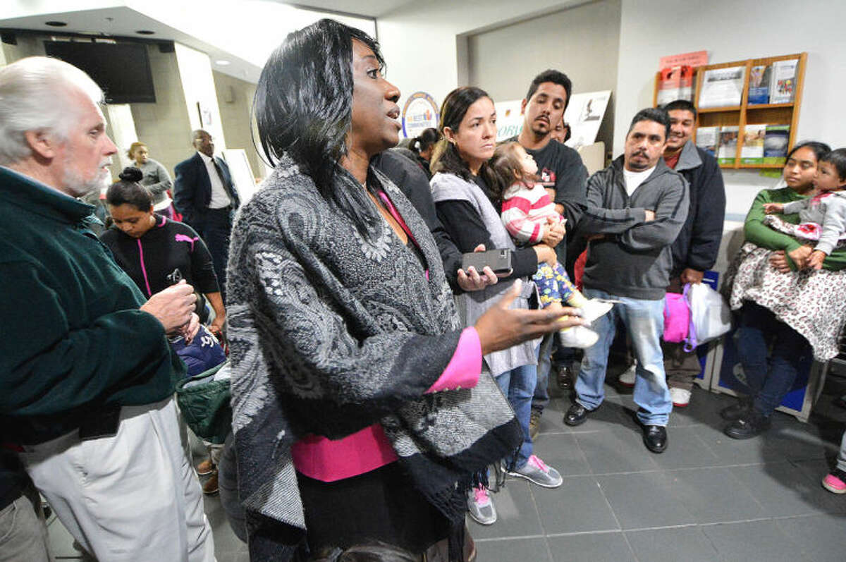 Hour Photo/Alex von Kleydorff. Chiquita Stephenson in the middle of angry parents that filled the entrance to City Hall protesting the Federal shut down of the Head Start program Thursday