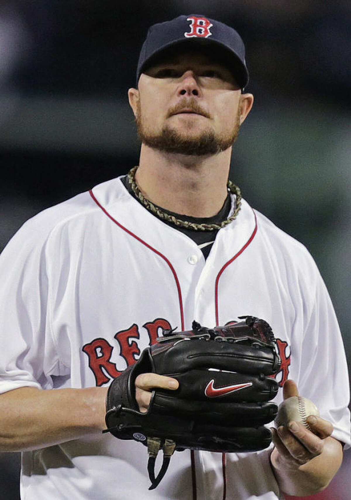 """In this photo taken Wednesday, Oct. 23, 2013, Boston Red Sox starting pitcher Jon Lester waits to throw during the first inning of Game 1 of baseball's World Series in Boston. Tyler Melling, a Cardinals minor leaguer has suggested Lester may have used a foreign substance to aid his pitches during his win over St. Louis in the World Series opener. Melling wrote Wednesday night on Twitter: """"Jon Lester using a little Vaseline inside the glove tonight?"""" with a screen shot appearing to show discoloration on Lester's black glove. (AP Photo/Charles Krupa)"""