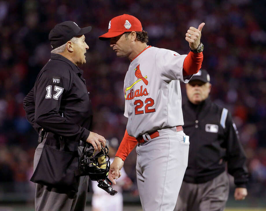 St. Louis Cardinals manager Mike Matheny argues a call with umpire John Hirschbeck during the first inning of Game 1 of baseball's World Series against the Boston Red Sox Wednesday, Oct. 23, 2013, in Boston. (AP Photo/Matt Slocum) / AP