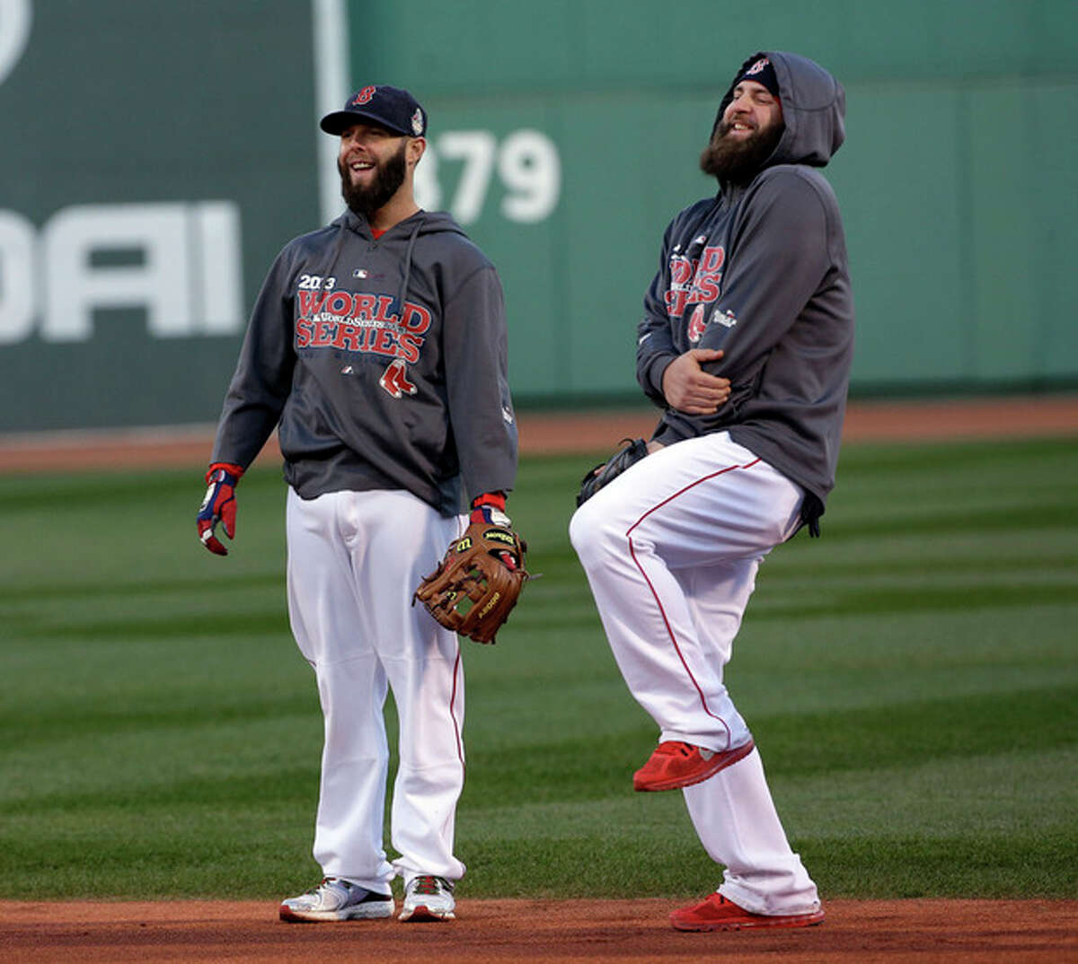 Boston Red Sox's Mike Napoli, right, and Dustin Pedroia have some fun during batting practice before Game 2 of baseball's World Series against the St. Louis Cardinals Thursday, Oct. 24, 2013, in Boston. (AP Photo/David J. Phillip)