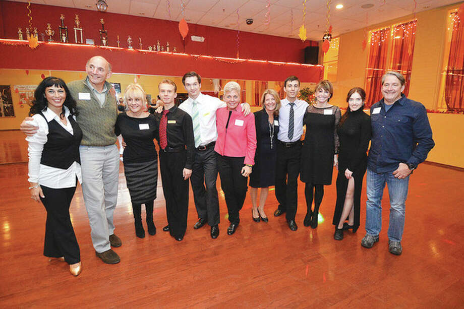Hour Photo/Alex von Kleydorff. FredAstaire Dance Studio owner Gina Goethche with her pro dancers pose with the Star dancers Peter Tauck, Gina Zangrillo, Cyndi Bigelow, Ruthann Walsh and Gus Pappajohn to benefit Elderhouse