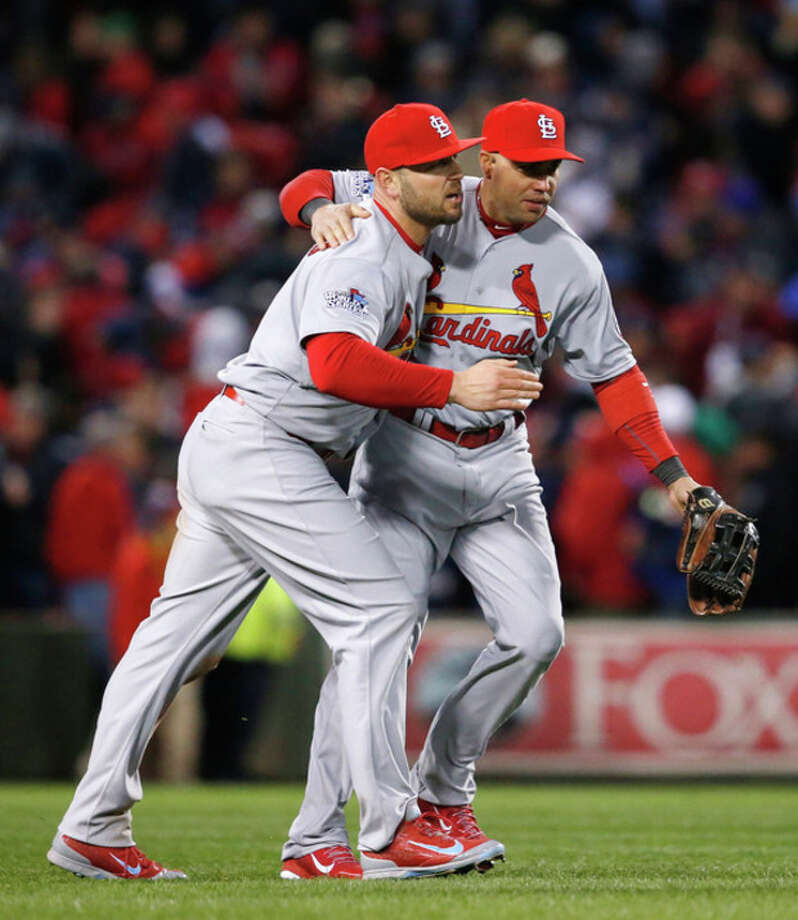 St. Louis Cardinals' Matt Holliday, left, and Carlos Beltran celebrate following Game 2 of baseball's World Series against the Boston Red Sox Thursday, Oct. 24, 2013, in Boston. The Cardinals won 4-2 to tie the series at 1-1. (AP Photo/Elise Amendola) / AP