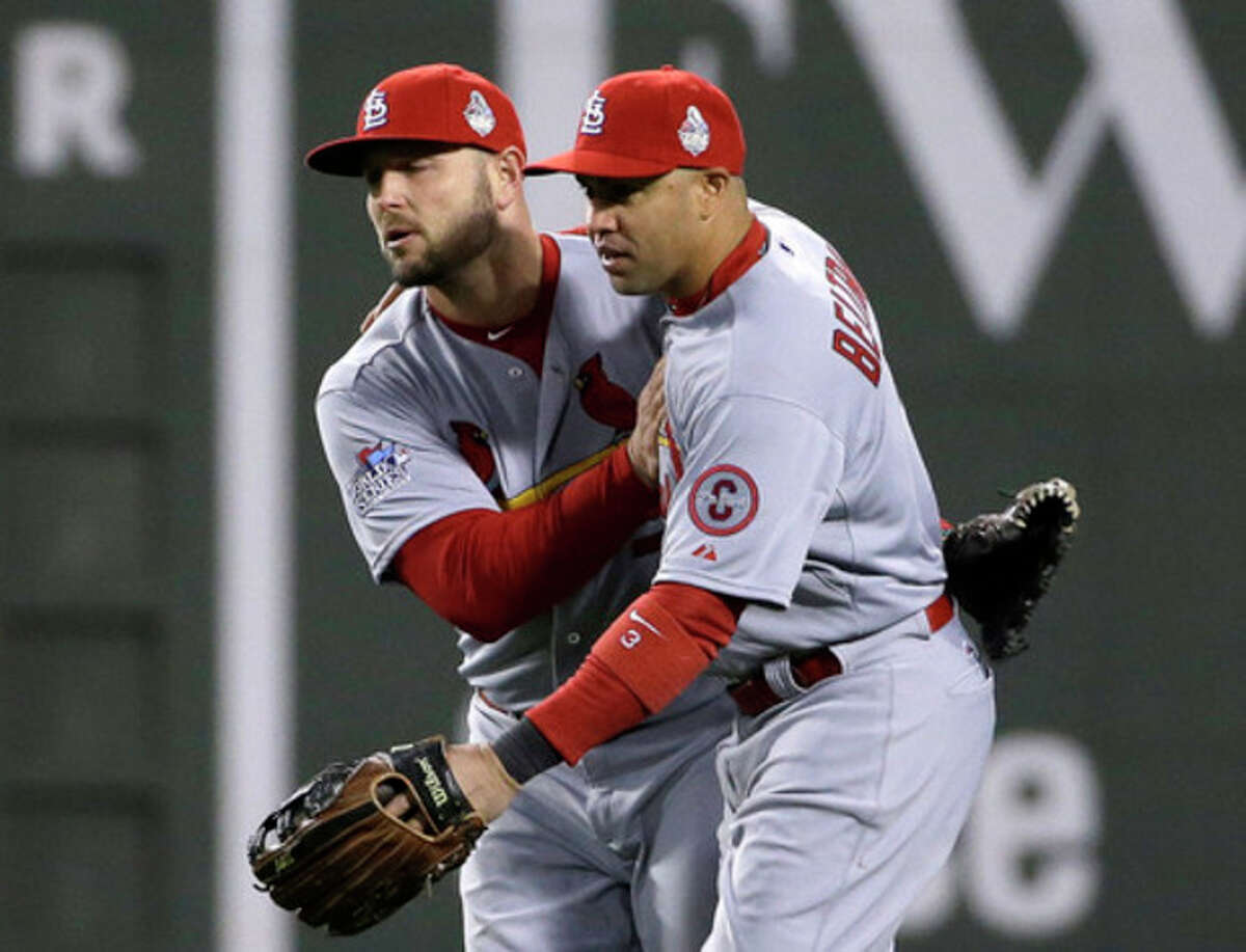 St. Louis Cardinals' Matt Holliday, left, and Carlos Beltran celebrate after Game 2 of baseball's World Series against the Boston Red Sox Thursday, Oct. 24, 2013, in Boston. The Cardinals won 4-2 to tie the series at 1-1. (AP Photo/David J. Phillip)