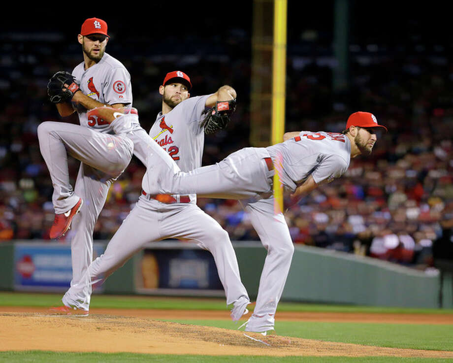 In this multiple exposure image, St. Louis Cardinals starting pitcher Michael Wacha throws during the fifth inning of Game 2 of baseball's World Series against the Boston Red Sox Thursday, Oct. 24, 2013, in Boston. (AP Photo/Matt Slocum) / AP