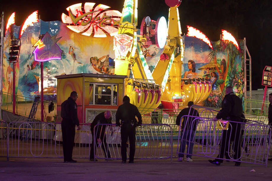Fairgrounds Police secure a barricade around the Vortex after an accident closed the ride just after 9 p.m. on Thursday Oct. 24, 2013 at the N.C. State Fair in Raleigh, N.C. The accident occurred on the ride at the North Carolina State Fair on Thursday night, sending five people to the hospital with unknown injuries. (AP Photo/The News & Observer, Robert Willett) / THE NEWS & OBSERVER