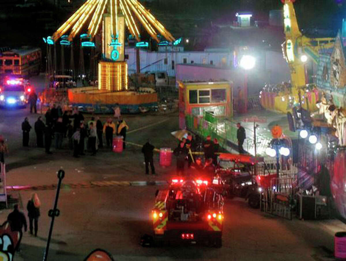 In this photo provided by WNCN, emergency crews respond to the scene where a ride malfunctioned at the North Carolina State Fair, Thursday, Oct. 24, 2013 in Raleigh, N.C. Several people were sent to the hospital with unknown injuries. (AP Photo/WNCN) MANDATORY CREDIT: WNCN